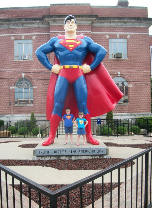My kids at the Superman statue, June 2011